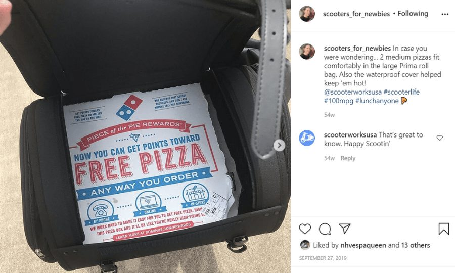 Instagram image of roll bag with lid held open to show pizza boxes on the inside.