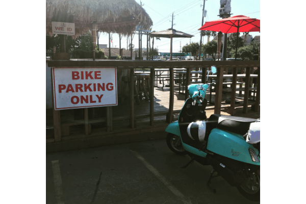 Park scooter in motorcycle areas if designated