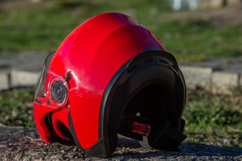 red helmet that appears to have fallen & likely caused damage.