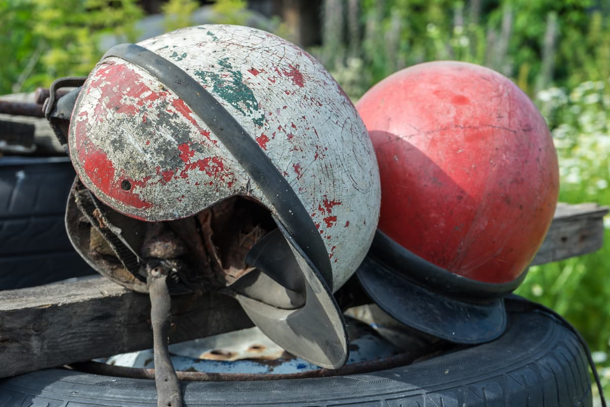 helmets with visible cracks and scuffs